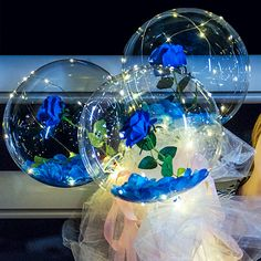 Luminous 3 Blue roses inside 3 transparent balloon with White and Blue Wrapping
