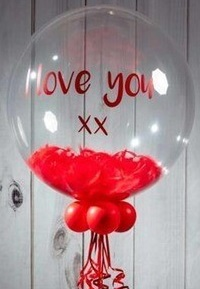 Love you printed on bubble transparent balloon with petals inside and 3 red balloons