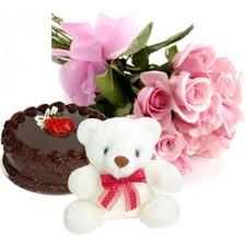 A bouquet of 12 roses 1/2 kg cake and teddy