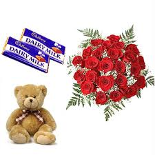 A bouquet of 15 red roses 2 chocolates and a teddy bear