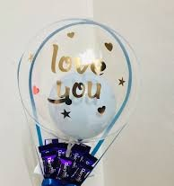 1 bubble balloon with love you print and chocolates bouquet