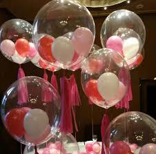Small white red and pink balloons stuffed in 5 transparent balloons for party decoration