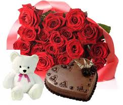 A bouquet of 40 red roses 1 kg chocolate truffle heart cake and a teddy bear