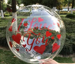 One transparent balloon with print I Love you and red hearts