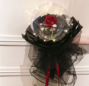 Transparent balloon with 1 red rose black wrapping and fairy lights
