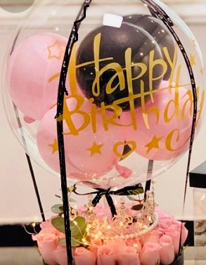 Pink black Balloon inside clear bubble balloon with 20 pink roses and fairy lights