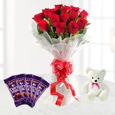 A bouquet of 10 red roses 4 silk chocolates and teddy bear