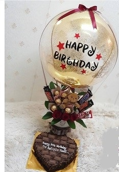 Happy Birthday printed hot air balloon with Teddy 5 Ferrero Rocher chocolates 5 dairy milk small chocolates in basket Cake 1 kg chocolate heart shape