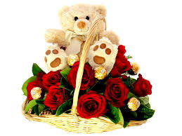 5 ferrero rocher chocolates 8 red roses and teddy all in a basket