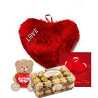 A red cushion heart, card, 16 ferrero rocher chocolates and teddy bear