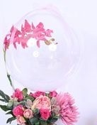 Transparent Balloon with 1 Purple Orchid trailing on the balloon tied to 12 pink and white roses basket
