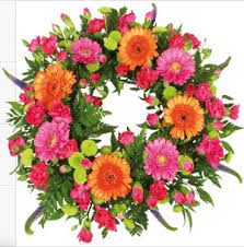 A wreath of roses and assorted flowers