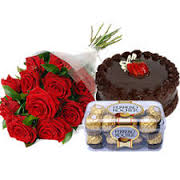 A bouquet of 15 red roses 16 ferrero chocolates and a 1/2 kg cake