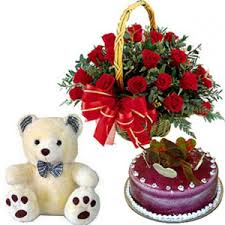 A basket of 12 roses 1/2 kg cake and teddy