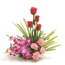 A basket of roses, carnations and orchids