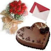 A bouquet of 20 red roses 1 kg chocolate truffle heart cake and a greeting card