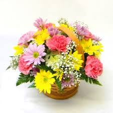 20 gerberas and carnations in a basket