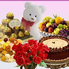 1/2 kg cake with 1/2 kg mithai and 16 ferrero rocher chocolates fruits and teddy bear