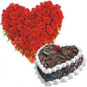 A heart Arrangement of 20 red roses and 1 kg heart black forest cake