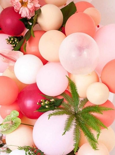 Pink white red air balloons with flowers in between