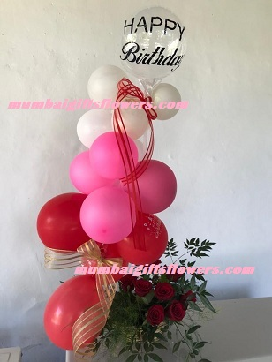 Pink red white balloons arrangement with roses and happy birthday balloon