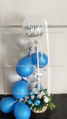 Blue silver balloons arrangement with roses and happy birthday balloon