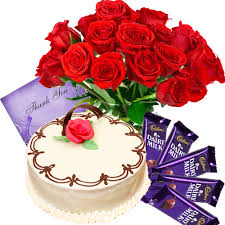 A bouquet of 12 red roses 1/2 kg chocolate truffle cake 4 silk chocolates a card