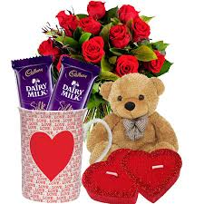A bouquet of 15 red roses 2 chocolates and a teddy bear with coffee mug and 2 cushion hearts