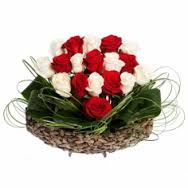 An Arrangement of 15 red and white roses