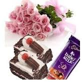 A bouquet of 12 roses with 2 pastries and 1 silk chocolate bar