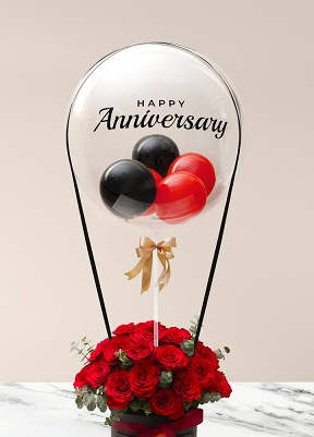 Happy transparent printed transparent balloon with 4 black and red balloons and 20 red roses arrangement Available in Delhi Noida Gurgaon Faridabad Mumbai Chandigarh Mohali Panchkula Dehradun Pune