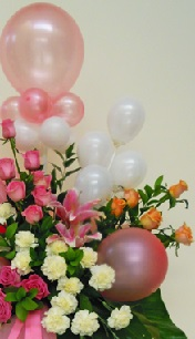 6 Pink and 6 White small balloons arranged with 6 Pink roses 10 white carnations 6 Orange roses