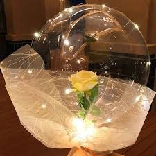 1 Luminous LED Balloons with 1 yellow rose inside transparent balloon with white Wrapping