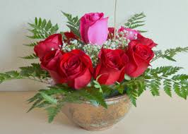 14 red roses 1 pink rose in the center arrangement