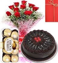 8 red roses bunch 16 ferrero rocher chocolates 1/2 kg chocolate cake and card