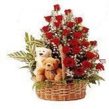 two teddy bears with 24 roses in same basket