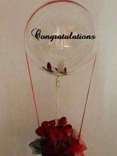 CONGRATULATIONS printed transparent balloon with 8 red roses arrangement Only for Pune