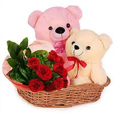 two teddy bears with 12 roses in same basket
