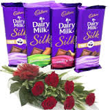 4 silk chocolates with 6 red roses