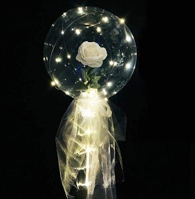 White Net covering white rose swallowed in 1 Transparent Balloon tied with white ribbons